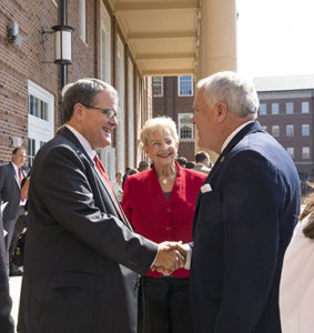 UGA President Jere W. Morehead shakes hands with Gov. Nathan Deal as Georgia first lady Sandra Deal looks on during Friday's dedication and groundbreaking at the Terry Business Learning Community. (Chad Osburn/UGA)