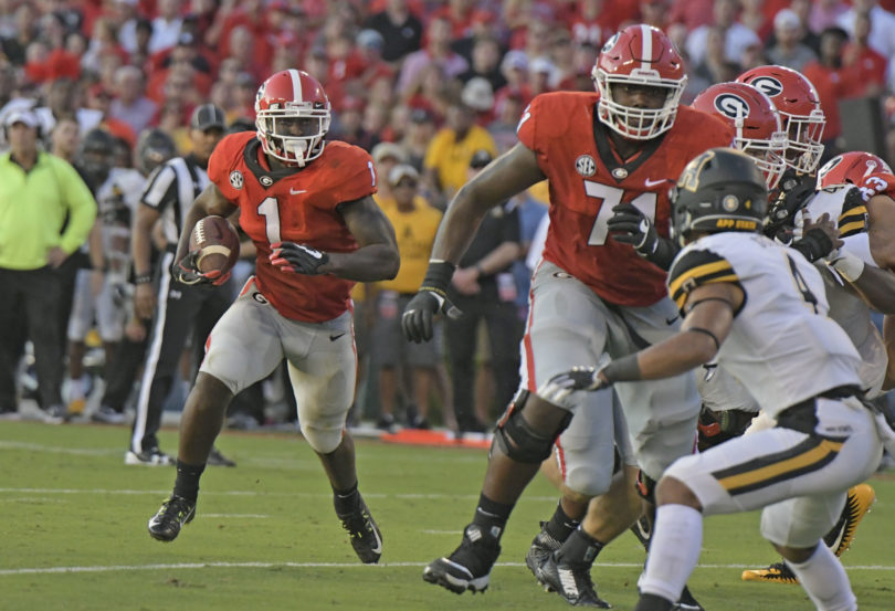Georgia offensive lineman Andrew Thomas (71) blocks for Georgia tailback Sony Michel (1) during the Georgia Bulldogs' football game against the Appalachian State Mountaineers at Sanford Stadium on Saturday, September 2, 2017 in Athens, Georgia. (photo by John Kelley/UGA)