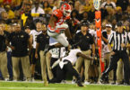 Georgia tailback Nick Chubb leaps over a Missouri defender during Saturday's Homecoming victory. (Photo: Andy Harrison)