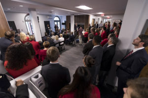 Undergraduate management major Lavette Leflore speaks to a full lobby of attendees during the dedication ceremony and open house for the renovation of Clark Howell Hall. (Andrew Davis Tucker/UGA)