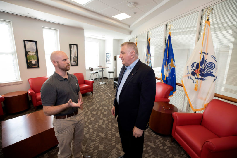 Military veterans Dave Allen, left, and Keith Harris chat in the First Data Student Veterans Lounge at the Tate Student Center. (Dorothy Kozlowski/UGA)