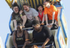 Photojournalism students at Fair ride-h