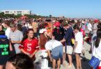 Georgia-Florida Football Weekend Community Beach Sweep - people on beach - 2012-h.group