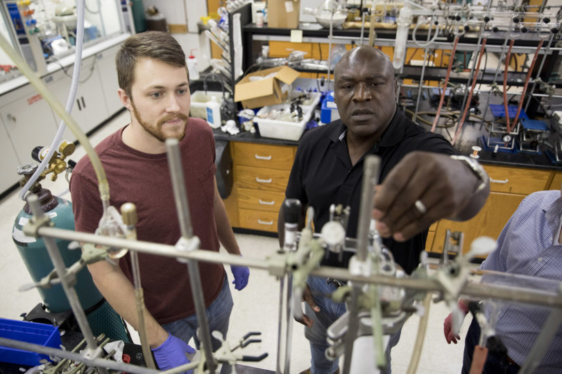 Gregory Robinson, Franklin Professor in the department of chemistry, works with a student in his research laboratory.