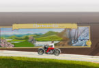A motorcycle drives in front of a Clarkesville mural.