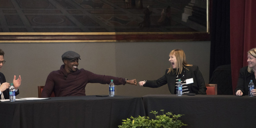 Will Packer and Gale Anne Hurd exchange a fist bump during the discussion.