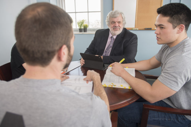 "Alexander W. ""Alex"" Scherr (center), 30-plus year public service lawyer and educator who will direct the UGA School of Law's Veterans Legal Clinic, discusses future clinic operations with law students."
