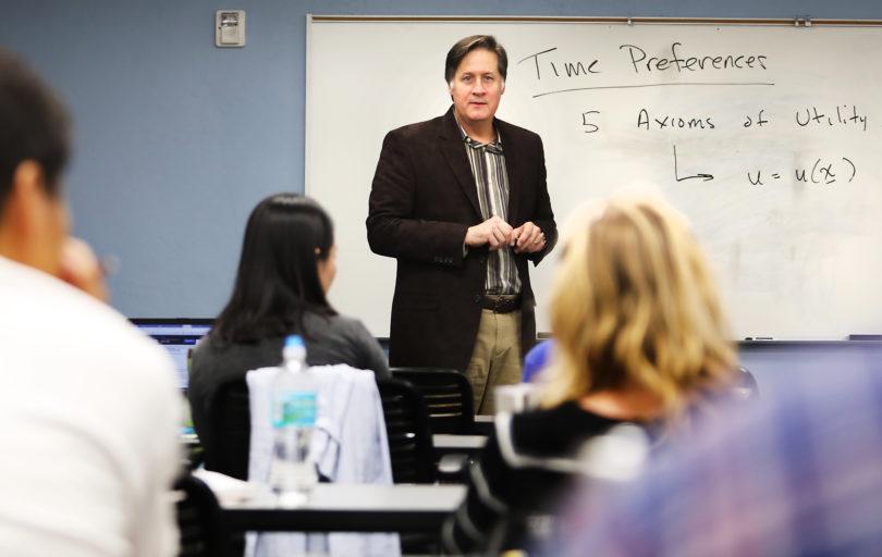 David Bradford lecturing in his classroom at UGA.