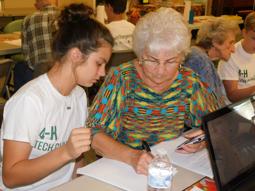Murray County 4-H member Charlsey Richards instructs her grandmother and Tech Changemaker participant Betty Sue Grooms.