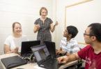 "Assistant professor Dorothy Carter discusses the NASA project with undergraduates Lindsay Huizer, Jeffrey John and Guohao ""Frank"" Wu."