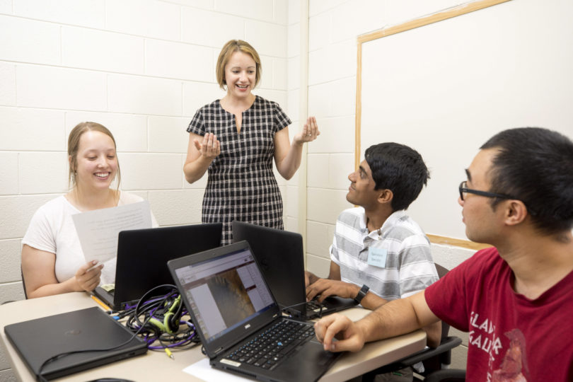"Assistant professor Dorothy Carter discusses the NASA project with undergraduates Lindsay Huizer, Jeffrey John and Guohao ""Frank"" Wu."