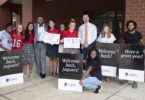 UGA students pose with Alton Standifer, fourth from, left, assistant to the president at UGA, and Cedar Shoals Principal Derrick Maxwell after welcoming students back on the first day of Clarke County Schools on Aug. 5.