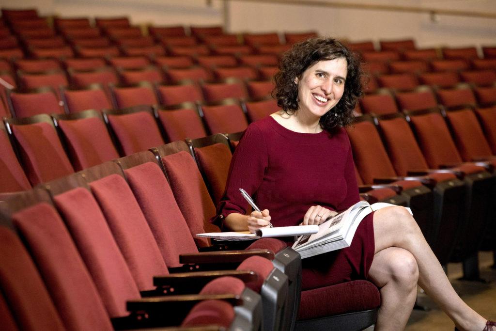 Photo of Emily Sahakian in the Fine Arts theatre.