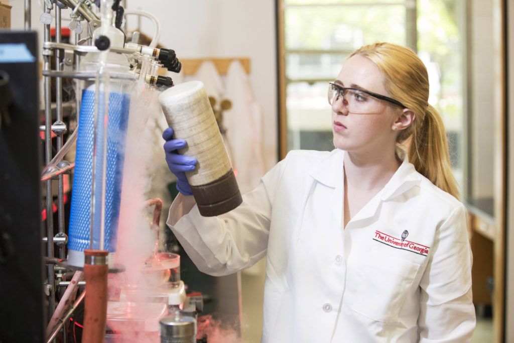 Photo of Kaitlin Luedecke working in a lab.