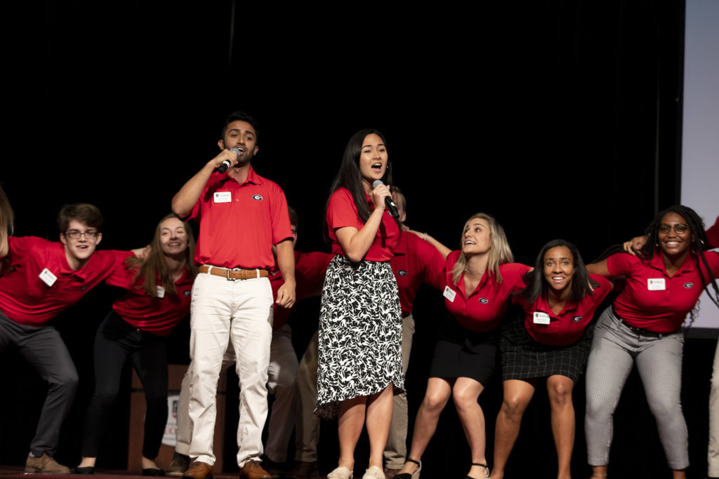 Photo of orientation leaders singing.