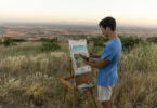 student painting a landscape in Cortona, Italy