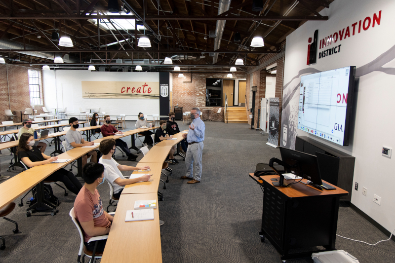 A professor teaches students in the Innovation Hub.