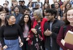 Charlayne Hunter-Gault poses with high school students.