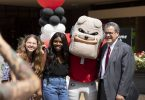 President Morehead poses with students.