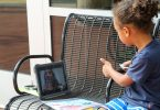 A child attending virtual school outside the Clarke County Public Library.