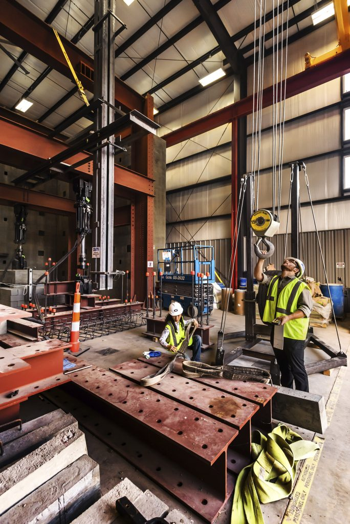 Engineers testing a steel beam