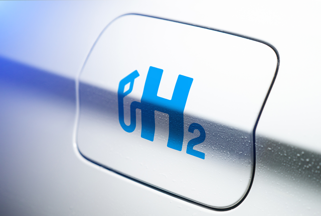 Graphic of an H with a fuel pump coming out of the letter and a 2 beside it.
