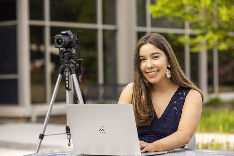 Kelly Krincek with her laptop and camera