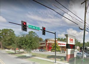 Photo of stoplight on a corner by a CVS Pharmacy.
