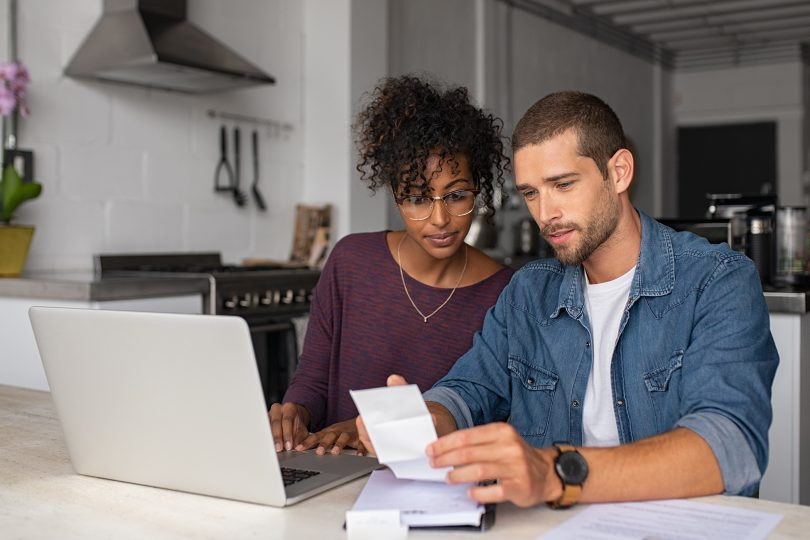 Couple looking at bills to pay.