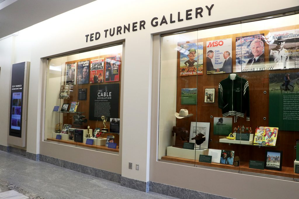 Image of two glass display cases with memorabilia
