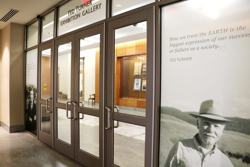 Doors and a photo of Ted Turner wearing a cowboy hat.