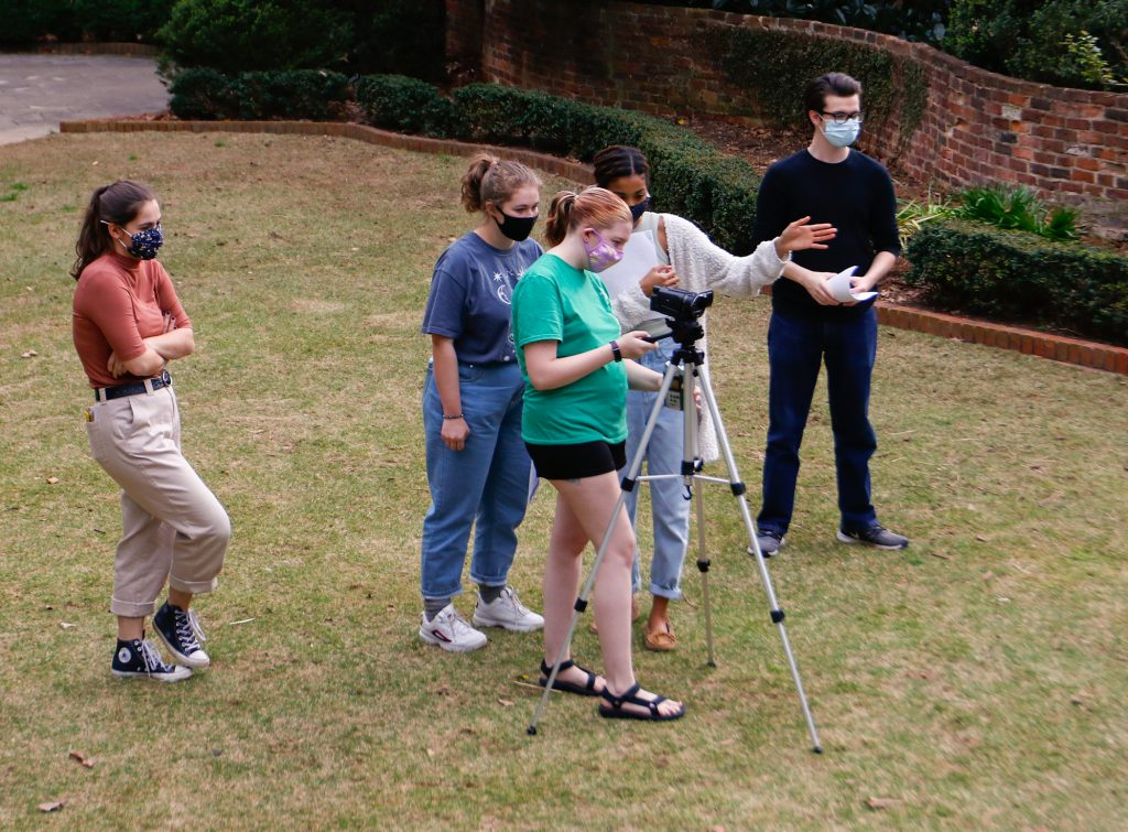 Students look through a video camera