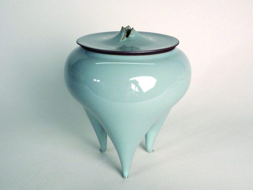 Light blue stoneware with three feet.