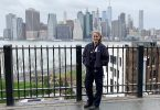 Maddy Wetterhall posing in front of New York City skyline.