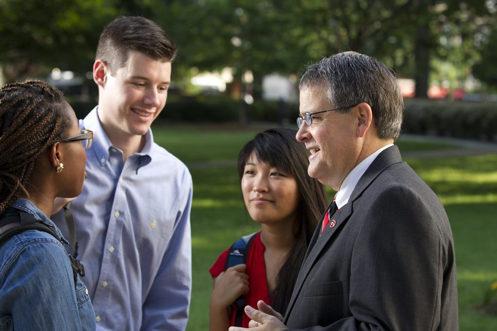President Morehead talking with students on campus.