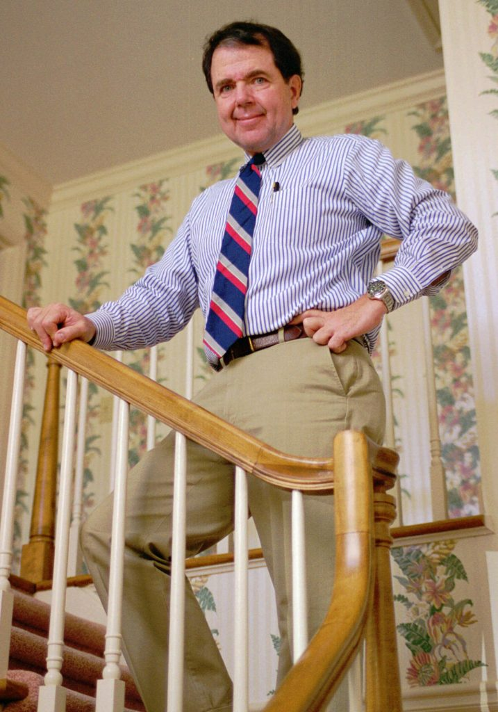 Thomas Stanley poses on the stairwell of his Atlanta home