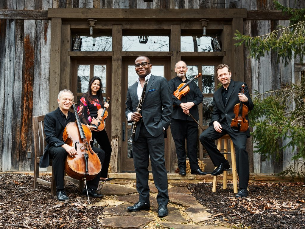 Anthony McGill poses with his band.