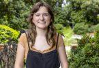 Portrait of Caroline Caden smiling in front of garden