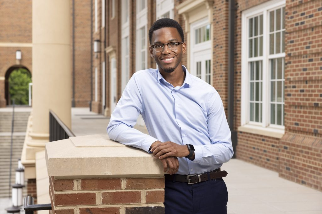 Portrait of Kevin Nwogu standing in the Business Learning Community,