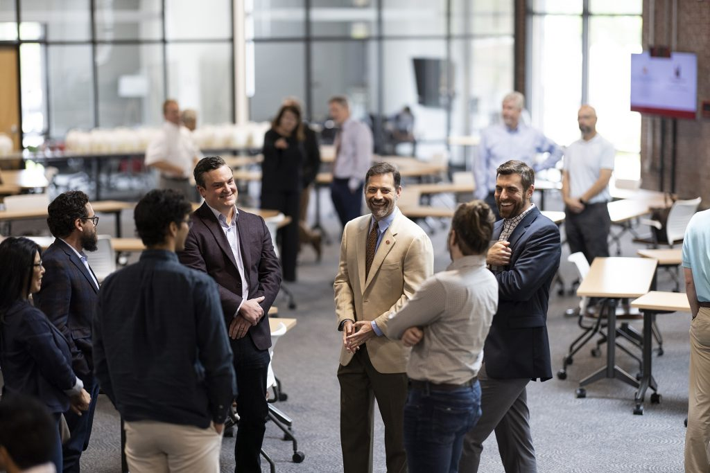 A group of people talking at the Innovation Hub