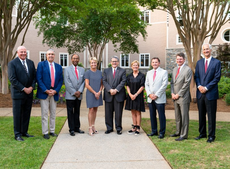 Pictured left to right: Neal J. Quirk Sr., John F. Mangan Jr., Steve C. Jones, Nancy C. Juneau, Jere W. Morehead, Bonney S. Shuman, Barry L. Storey, John H. Crawford IV and E. Howard Young. Not pictured: Executive Vice-Chair Allison C. Ausband pose for an outdoor portrait.