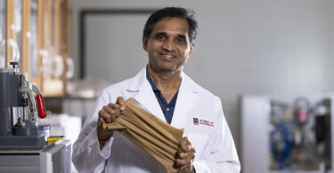 Gajanan Bhat holds an elastic nonwoven material.