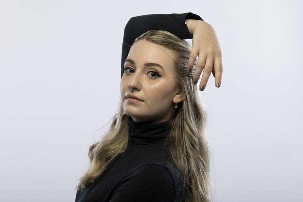 Portrait of Tori Watson in a dance pose
