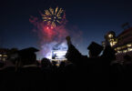 Graduates watch fireworks after Commencement.