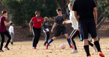 Students play a game of soccer