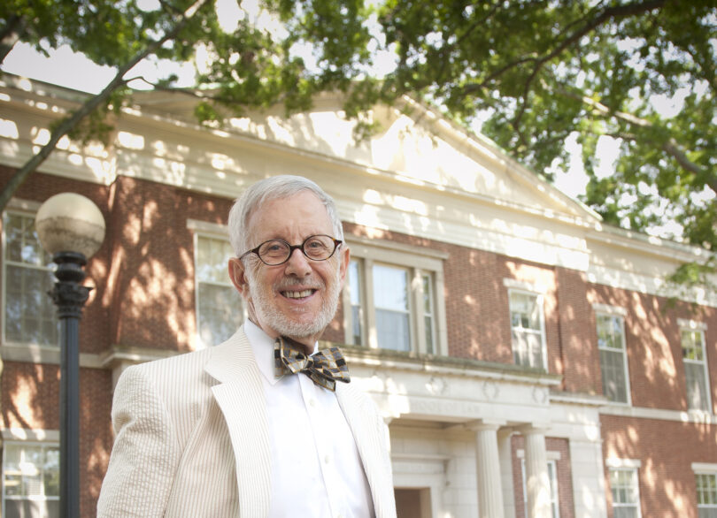 Portrait of Paul Kurtz in front of the law school