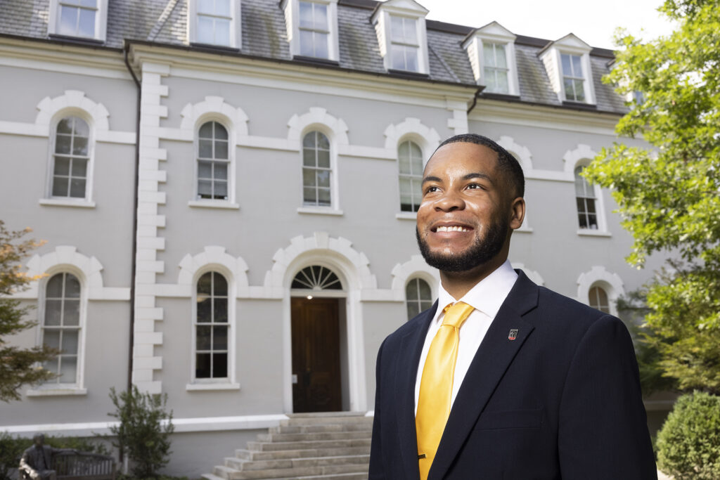 Portrait of Eric Okanume with Moore College in the background.