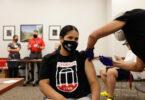 A nurse gives a vaccine to a UGA student.