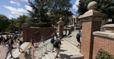 Students walking up steps on campus.