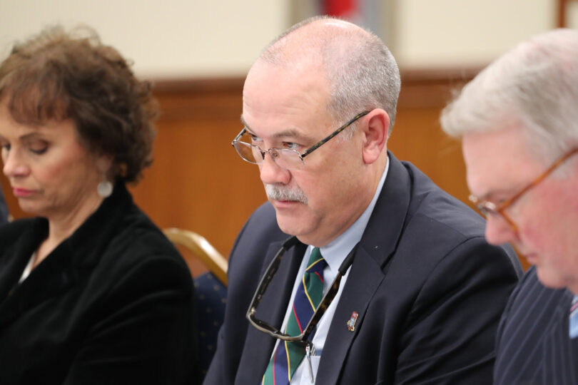 Judge Goss sitting at a table with two other people.